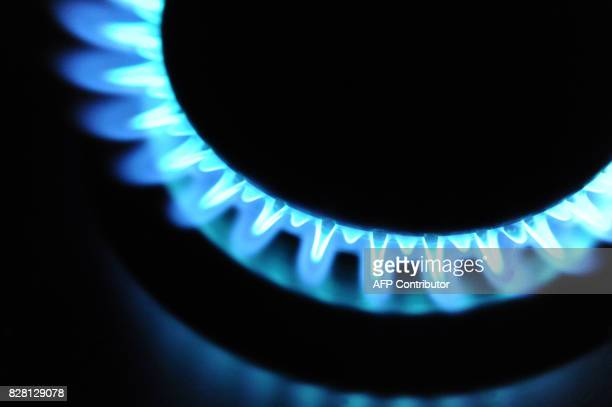 A picture taken on March 22 2012 in Quimper western France shows a gas burner working AFP PHOTO / FRED TANNEAU / AFP PHOTO / Fred TANNEAU