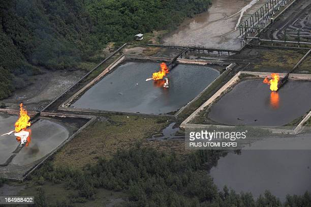 A picture taken on March 22 2013 shows gas flare at Shell Cawtharine Channel Nembe Creek in the Niger Delta Shell Petroleum Development Company of...