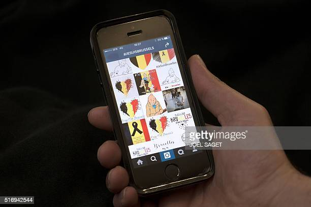 A picture taken on March 22 2016 in Paris shows a view of a smartphone screening an Instagram page with the ashtag '#JESUISBRUSSELS' and various...