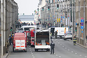 A picture taken on March 22 2016 shows Belgian police and emergency staff standing guard in the Wetstraat Rue de la Loi which has been evacuated...