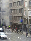 TOPSHOT A picture taken on March 22 2016 shows smoke rising from the Maalbeek Maelbeek underground in Brussels following a blast at the station close...