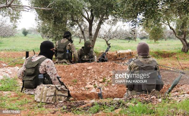 A picture taken on March 22 2017 near the town of Maardes in the countryside of the central Syrian province of Hama shows an armoured vehicle...