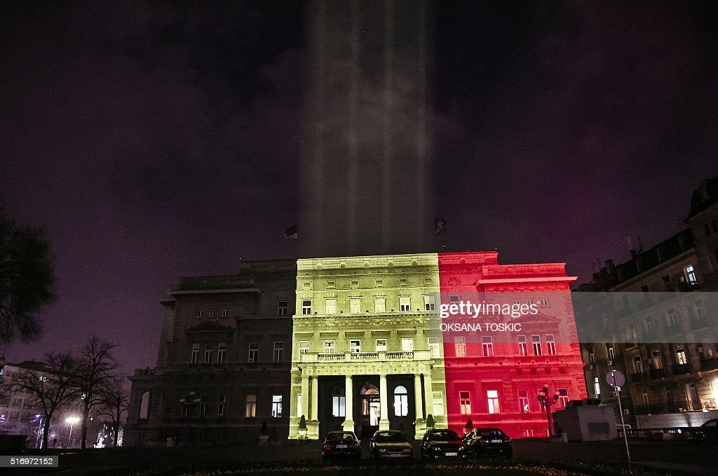 A picture taken on March 22 shows the town council building in Belgrade illuminated in the colours of the Belgian flag in tribute to the victims of...