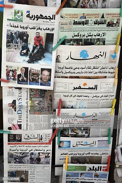 A picture taken on March 23 2016 at a kiosk selling magazines and newspapers in Beirut shows the frontpage of several Lebanese newspapers one day...