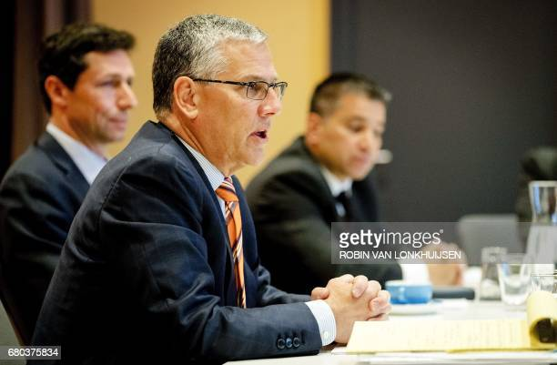 A picture taken on March 23 2017 shows PPG Industries CEO Michael McGarry talking to the press during a round table in Amsterdam The world's leading...