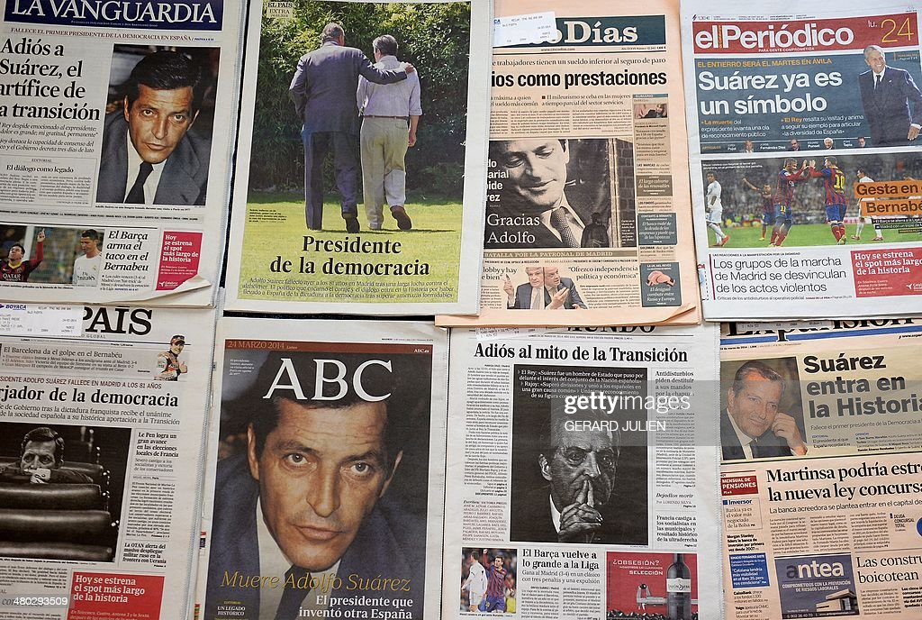 A picture taken on March 24, 2014 shows various Spanish newspaper front pages reporting news of the death of former Spanish Prime Minister Adolfo Suarez. Adolfo Suarez, the prime minister who led Spain to democracy after decades of dictatorship and became its first elected premier after the death of General Francisco Franco, died on March 23, 2014 aged 81.