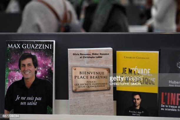 A picture taken on March 24 2017 shows the book 'Bievenue place Beauvau Police le secrets inavouables d'un quinquennat' by Olivia Recasens Didier...