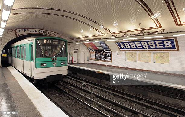 A picture taken on March 25 2010 in Paris shows a train running at the 'Abbesses' metro station on Line 12 of the Paris Metro in the Montmartre...