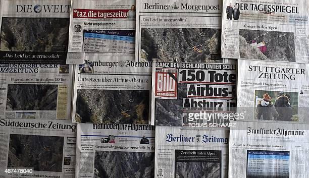 A picture taken on March 25 2015 in Berlin shows front pages of various German newspapers reporting on the Germanwings plane crash Budget airline...