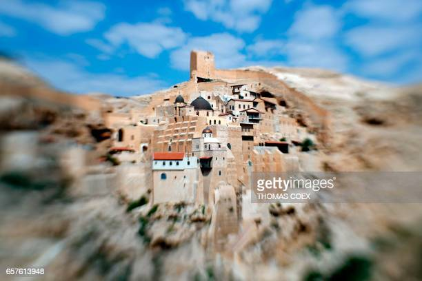 TOPSHOT A picture taken on March 25 2017 with a tiltshift lens shows a general view of the Greek Orthodox monastery of St Sabba also known as Mar...