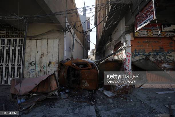 TOPSHOT A picture taken on March 25 shows the damaged streets of the Old City of Mosul during the government forces' ongoing offensive to retake the...