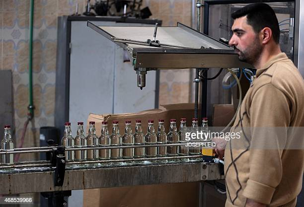 KETZ A picture taken on March 26 2015 in the central Syrian city of Homs shows an employee working on a production line of bottles of alMimas arak at...