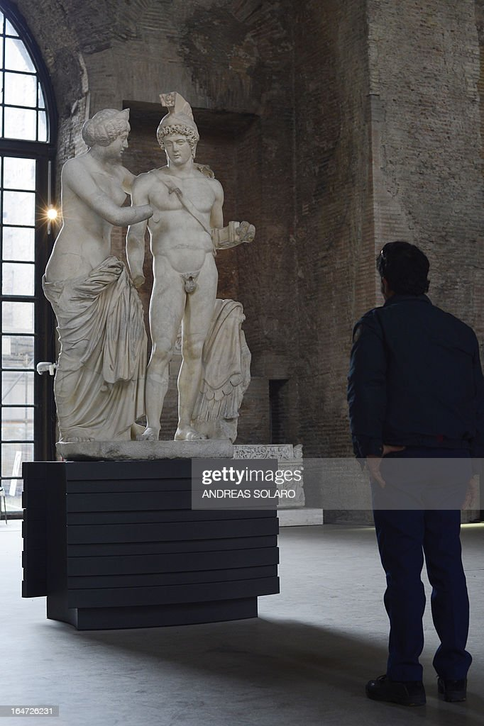 A picture taken on March 27, 2013 at the Museo nazionale delle Terme (Baths Museum) shows Roman statues of Mars and Venus. The controversial 'prostheses' of the two ancient statues of Mars and Venus which were added at the request of Silvio Berlusconi, exhibited at the Italian Government headquarters were removed, announced today Rome's newspaper 'Il Messaggero'. In 2010 Officials confirmed that a fake penis and hand had been added to Mars, the god of war and a fake hand had been added to Venus, the goddess of love after a consultation with Berlusconi's personal architect Mario Catalano.