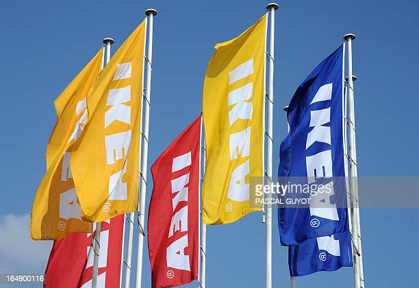 A picture taken on March 27 2013 shows flags bearing the name of Swedish furniture giant Ikea at the Odysseum shopping mall in Montpellier southern...