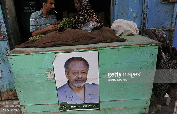 A picture taken on March 27 2016 in Djibouti shows a poster of Djiboutian president Ismaïl Omar Guelleh hung on the display stand of a shop Incumbent...