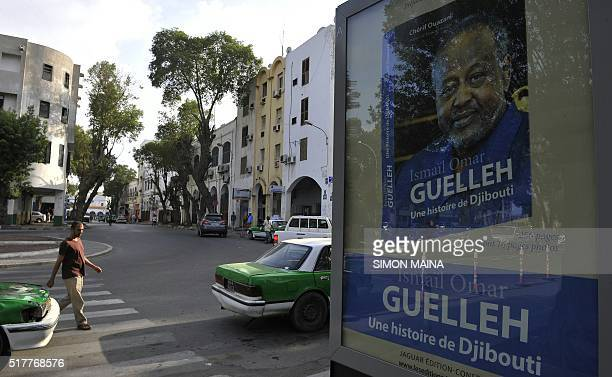 A picture taken on March 27 2016 in Djibouti shows an advertising poster for a book of Djiboutian president Ismaïl Omar Guelleh Incumbent President...