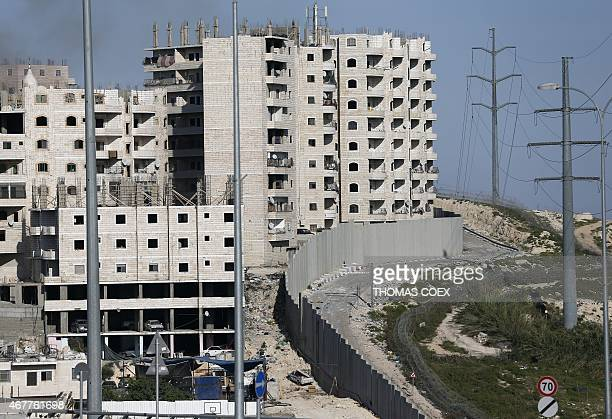 A picture taken on March 27 shows Israel's controversial separation barrier as it seperates between the east Jerusalem and the Shuafat refugee camp...