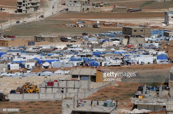 A picture taken on March 28 2014 shows tents housing Syrian refugees in the city of Arsal in Lebanon's Bekaa valley near the border with Syria The...