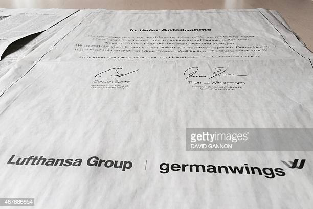 Picture taken on March 28 2015 shows the fullpage notice of condolence from German airlines Lufthansa /Germanwings for the victims of the Germanwings...