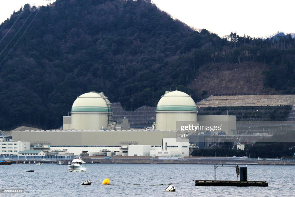 Picture taken on March 28, 2017 shows a general view of Takahama nuclear power plant in Takahama town, Fukui prefecture. A Japanese appeals court ruled on March 28, 3017 that Takahama nuclear power plant reactor No. 3 and No. 4 which were halted by a lower court in March 2016 order, can restarted, marking a victory for Prime Minister Shinzo Abe's energy policy. / AFP PHOTO / JIJI PRESS / STR / Japan OUT