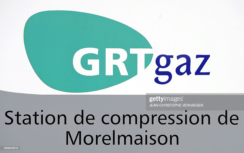 A picture taken on March 29, 2013 shows a GRTgaz logo ata GRTgaz compressor station, in Morelmaison,eastern France.A compressor station is a facility which helps the transportation process of natural gas from one location to another. Natural gas, while being transported through a gas pipeline, needs to be constantly pressurized in certain distance intervals (around 200km).GRTgaz owns and operates the longest high-pressure natural gas transmission network in Europe CHRISTOPHE VERHAEGEN