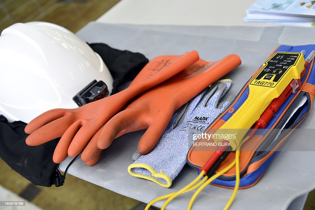 A picture taken on March 29, 2013 shows a technician equipment at the site of ERDF (Electricity Network Distribution France) in Saint-Ouen-l'Aumone, near Paris. AFP PHOTO BERTRAND GUAY