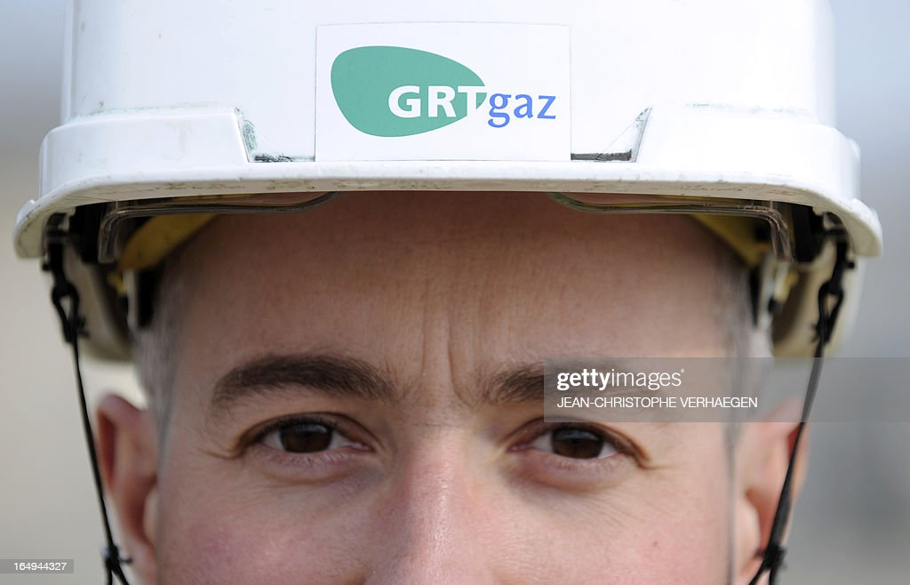 A picture taken on March 29, 2013 shows a worker wearing an helmet with a GRTgaz logo at a GRTgaz compressor station, in Morelmaison,eastern France. A compressor station is a facility which helps the transportation process of natural gas from one location to another. Natural gas, while being transported through a gas pipeline, needs to be constantly pressurized in certain distance intervals (around 200km). GRTgaz owns and operates the longest high-pressure natural gas transmission network in Europe CHRISTOPHE VERHAEGEN
