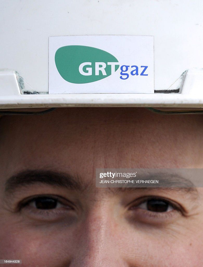 A picture taken on March 29, 2013 shows a worker wearing an helmet with a GRTgaz logo at a GRTgaz compressor station, in Morelmaison,eastern France. A compressor station is a facility which helps the transportation process of natural gas from one location to another. Natural gas, while being transported through a gas pipeline, needs to be constantly pressurized in certain distance intervals (around 200km. GRTgaz owns and operates the longest high-pressure natural gas transmission network in Europe CHRISTOPHE VERHAEGEN