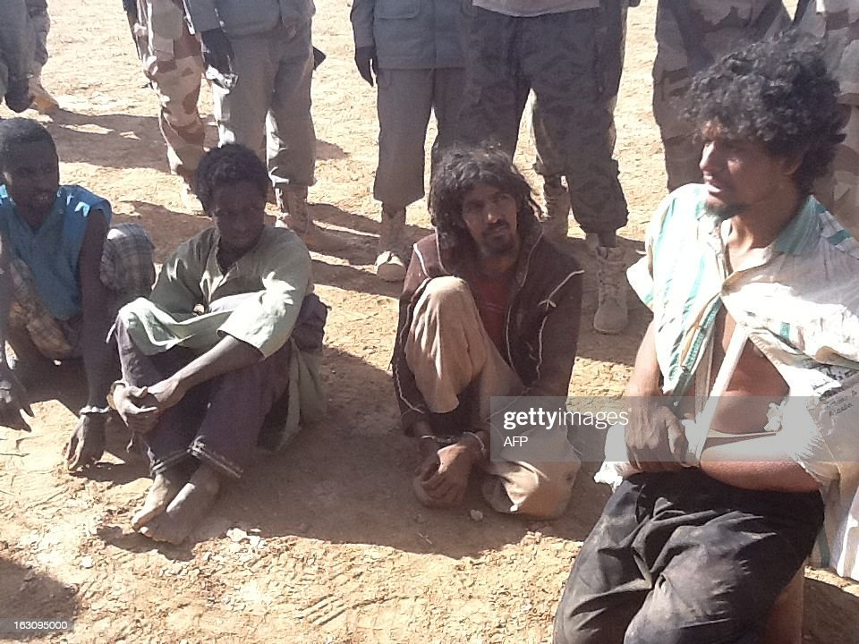 A picture taken on March 3, 2013 in Tessalit area shows alleged Islamist militants detained by the Chadian army after violent clashes in the Ifoghas mountains, northern Mali. Chad says its troops in northern Mali have killed Mokhtar Belmokhtar, the one-eyed Islamist leader who masterminded an assault on an Algerian gas plant in January that left 37 foreign hostages dead. The announcement came amid continued fighting in the mountains of northern Mali, where France on Sunday said a third French soldier had been killed since it launched operations against Islamist rebels in mid-January.