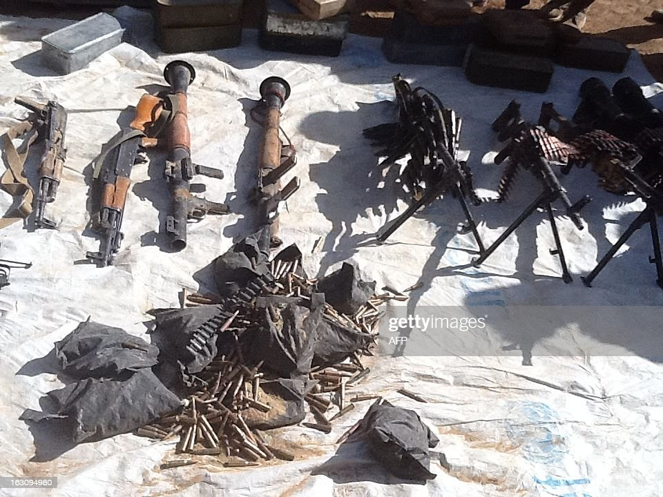 A picture taken on March 3, 2013 in Tessalit area shows weapons recovered by the Chadian army after violent clashes with Islamist militants in the Ifoghas mountains, northern Mali. Chad says its troops in northern Mali have killed Mokhtar Belmokhtar, the one-eyed Islamist leader who masterminded an assault on an Algerian gas plant in January that left 37 foreign hostages dead. The announcement came amid continued fighting in the mountains of northern Mali, where France on Sunday said a third French soldier had been killed since it launched operations against Islamist rebels in mid-January. AFP PHOTO / ALI KAYA