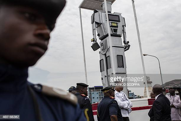 A picture taken on March 3 2015 in Kinshasa shows one of three new humanlike robots that were recently installed to help tackle the hectic traffic...