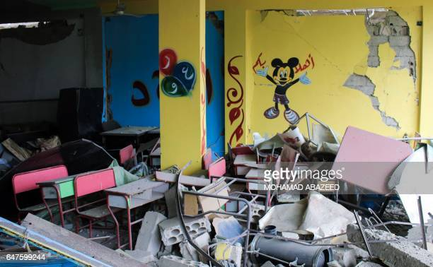 A picture taken on March 3 2017 shows a destroyed kindergarten in a rebelheld area of the southern Syrian city of Daraa after a reported air strike...