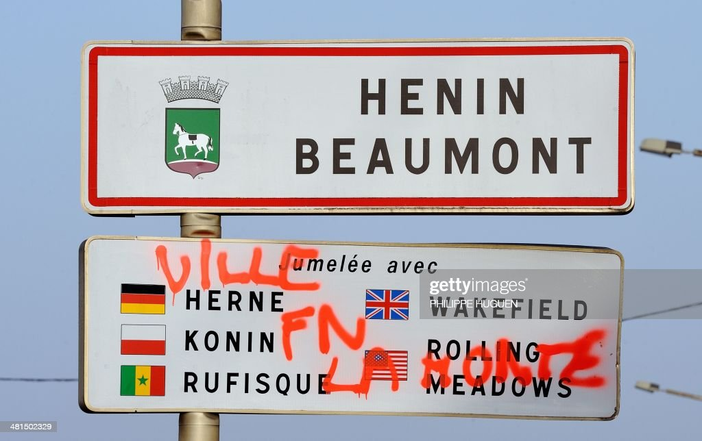 A picture taken on March 30, 2014 shows a city-entrance sign with the inscription 'City FN (Front National far-right party) Shame' after the election of the French far-right Front National (FN) party's candidate Steeve Briois as the new mayor of Henin-Beaumont. Briois was elected in the first round with 50,26 of votes. AFP PHOTO PHILIPPE HUGUEN