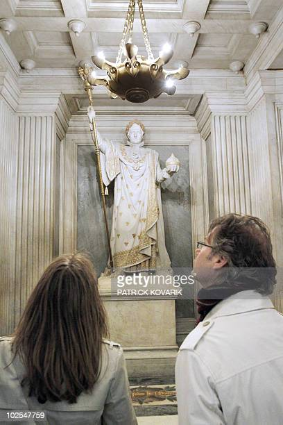 A picture taken on March 31 2010 in Paris shows visitors looking at a statue of Napoleon under which lies his son Napoleon II 'the Eaglet' at the...