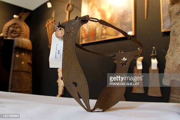 A picture taken on March 31 2012 in Paris shows a chastity belt on display during the 'Peines et chatiments d'autrefois' exhibition at the Fernand...