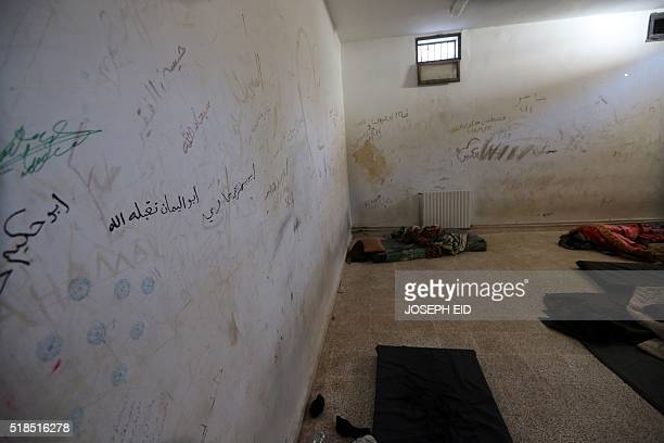 A picture taken on March 31 2016 shows makeshift beds at a former prison cell that was used by Islamic State fighters in the ancient city of Palmyra...
