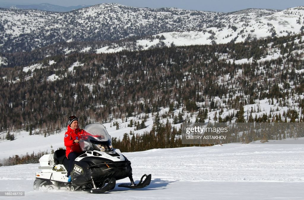 A picture taken on March 31, 2013, shows Russian Prime Minister Dmitry Medvedev riding a snowmobile at Sheregesh ski resort in the Kemerovo region of Russia.