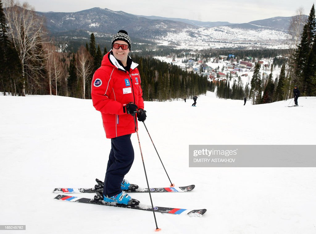 A picture taken on March 31, 2013, shows Russian Prime Minister Dmitry Medvedev skiing at Sheregesh ski resort in the Kemerovo region of Russia.