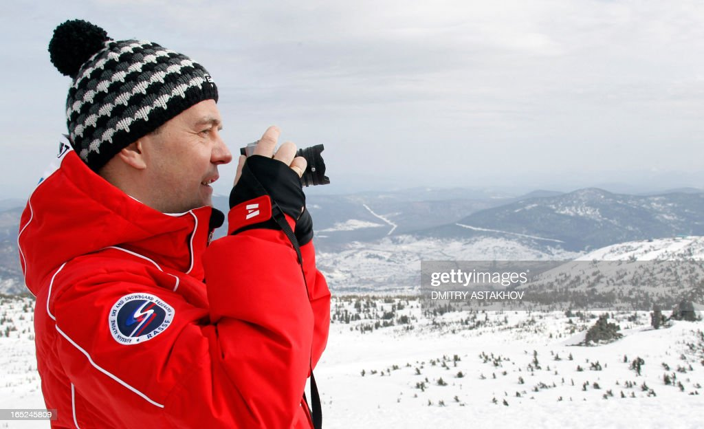 A picture taken on March 31, 2013, shows Russian Prime Minister Dmitry Medvedev taking photos at Sheregesh ski resort in the Kemerovo region of Russia.