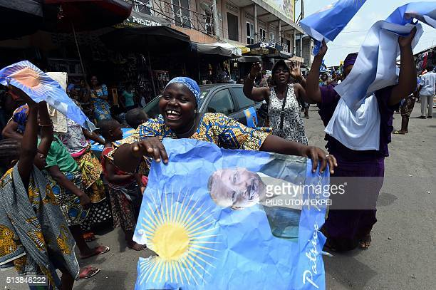 A picture taken on March 4 2016 shows supporters dancing with posters of cotton tycoon and presidential candidate Patrice Talon during a rally in...