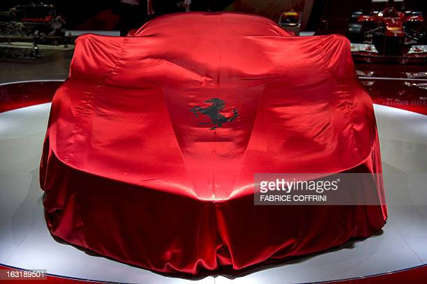 A picture taken on March 5 2013 shows the new La Ferrari hybrid model car waiting to be unveilled as World premiere at the Italian car maker's booth...