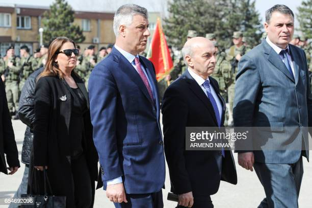 A picture taken on March 5 2017 in Pristina shows Kosovo President Hashim Thaci and Kosovo Prime Minister Isa Mustafa as they pass by members of the...