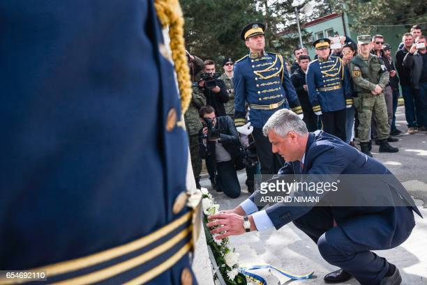 A picture taken on March 5 in Pristina shows Kosovo's President Hashim Thaci laying a wreath of flowers next to members of Kosovo Security Force...