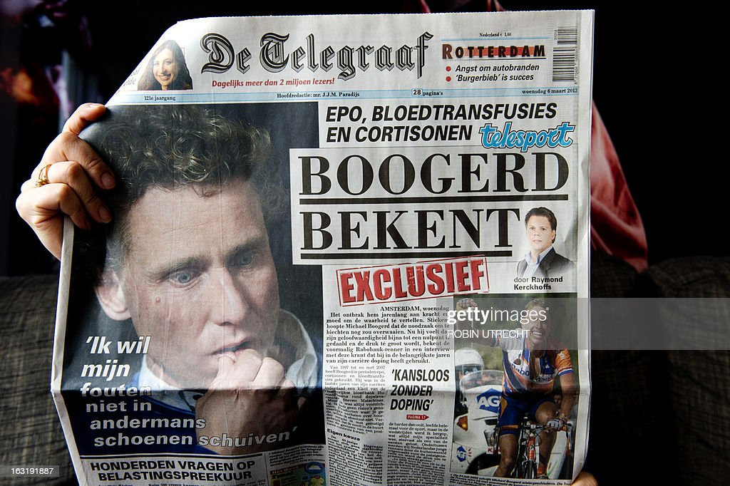 A picture taken on March 6, 2013 in Rotterdam shows a copy of Dutch daily newspaper De Telegraaf dated March 6, reading 'Boogerd confesses' on its front page and showing a portrait of former Dutch cyclist Michael Boogerd who confessed to have used doping during his career. Boogerd said in an exclusive interview to De Telegraaf newspaper published on March 6 that he has been using EPO, blood transfusions and cortisone from 1997 until the end of his career in 2007. AFP PHOTO / ANP ROBIN UTRECHT -- netherlands out --