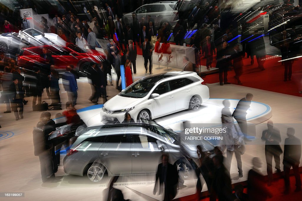 A picture taken on March 6, 2013 shows a general view of international carmakers' booths during the 83rd Geneva Motor Show in Geneva. The European crisis hovered like a dark cloud over the Geneva International Motor Show, but there was no lack of new luxury cars shining on the showroom floor. The event, considered one of the most important car shows of the year, will nonetheless be marked by the continent's economic and debt crisis again after an already catastrophic year in 2012.