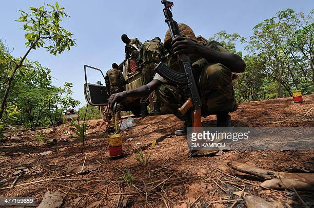 A picture taken on March 6 2014 shows a Chadian soldier serving with the Africanled MISCA force heating his daily ration during a patrol between...