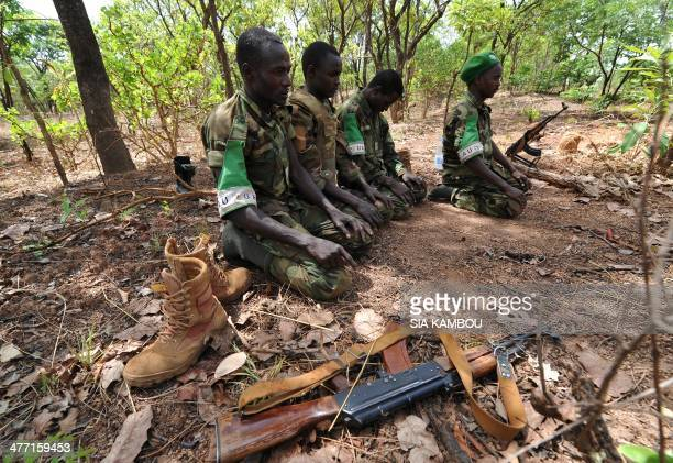 A picture taken on March 6 2014 shows Chadian soldiers serving with the Africanled MISCA force praying in Bossangoa Top UN officials said that a...