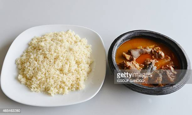 A picture taken on March 6 2015 in Abidjan shows a plate of Attieke with a dish of lamb in sauce a classic of the Ivorian food Originated from...