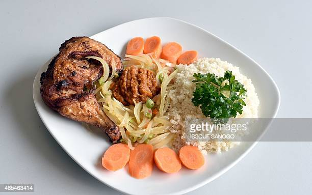 A picture taken on March 6 2015 in Abidjan shows a plate of Attieke with chicken a classic of the Ivorian food Originated from southern Ivory Coast...
