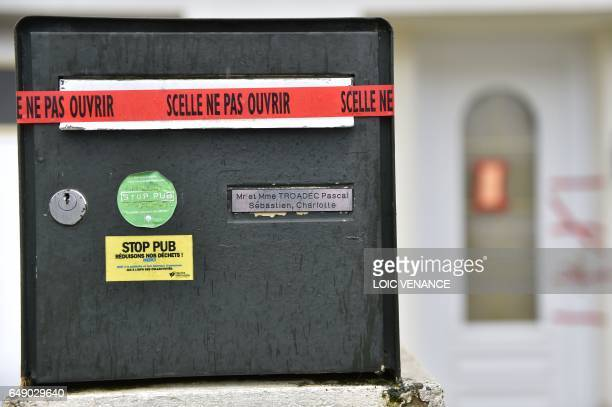 A picture taken on March 7 2017 in Orvault western France shows police sealed displayed on the mail box and the entrance of the house of the Troadec...